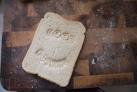 """""""Good morning"""" stamped into bread"""