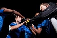 Soccer team planning game in huddle