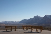 Empty park benches in desert