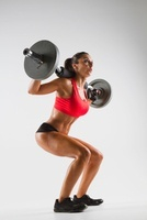 Female weightlifter using barbell