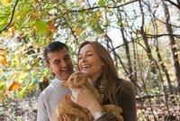 Happy couple with pet cat