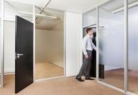 Office worker in office doorway