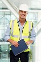 Portrait of engineer wearing hard hat in office