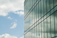 Cloudy blue sky reflected in office windows