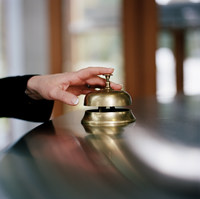 Businesswoman using service bell, close up