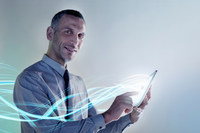 Businessman using digital tablet with lights