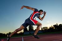 Male athlete leaving starting blocks
