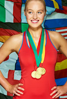 Young woman in front international flags wearing medals