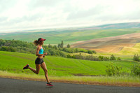 Young woman running in landscape of Palouse Hills, Washingto
