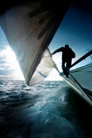 Silhouette of man on sailing boat