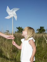 Girl holding a wind-driven
