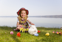 girl with bunny and easter eggs
