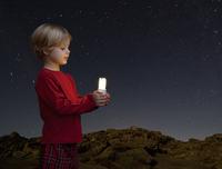 Boy with energy saving light bulb