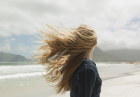 Young womans hair blowing in wind