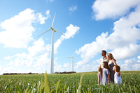 Family looking at wind turbines