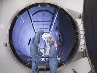 Workers with satellite testing chamber