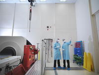 Worker in satellite testing station