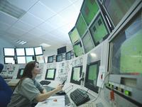 Scientist in accelerator control room