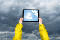 Child viewing storm on tablet computer