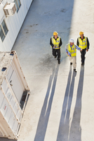 Workers casting shadows on site