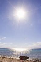 Sun shining over sandy beach