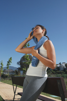 Runner wiping sweat from face