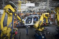 Robots welding car body in car factory