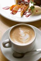 Still life of frothy coffee with plate of tart and ice cream 11015227381| 写真素材・ストックフォト・画像・イラスト素材|アマナイメージズ