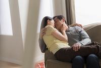 Mature couple hugging on sofa