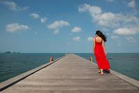 Woman on pier, Taling Ngam Beach, Ko Samui, Thailand