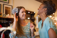Two friends buying hair accessory in vintage shop