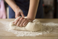 Hands kneading bread dough
