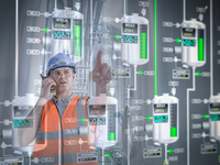 Factory supervisor monitoring product levels on interactive