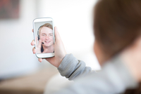 Young woman making video call on cellphone