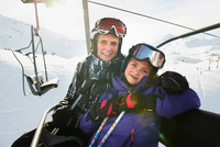 Portrait of grandmother and granddaughter on ski lift, Les A