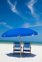 Deckchairs and parasol on beach, Clearwater, Florida, United