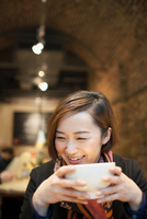 Young woman drinking coffee in restaurant