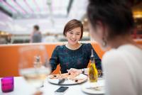 Young women enjoying meal in restaurant