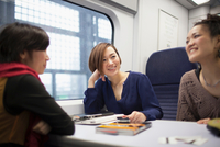 Young women talking on train