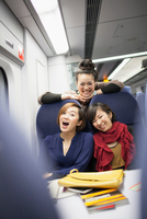 Young women on train laughing