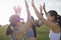 Three young female runners preparing to run