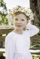 Portrait of young bridesmaid with floral headdress