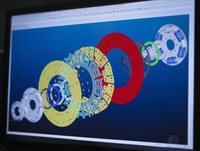 Industrial clutch designs using CAD software on computer screen