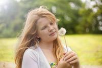 Girl holding dandelion clock