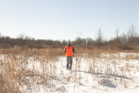 Teenage boy out hunting in Petersburg State Game Area, Michigan, USA