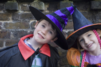 Portrait of boy and girl in halloween costumes