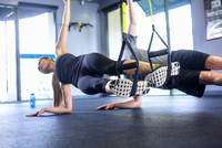 Couple doing side plank exercise