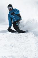Mid adult male skier on slope, Obergurgl, Austria