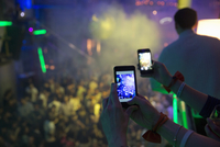Women taking photograph in nightclub with cellular phone