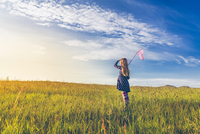 Girl carrying butterfly net in spring meadows, Reykjavic, Iceland
